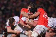 3 January 2020; Tom O'Toole of Ulster is tackled by Jack O'Donoghue, left, and Jack O'Sullivan of Munster during the Guinness PRO14 Round 10 match between Ulster and Munster at Kingspan Stadium in Belfast. Photo by Ramsey Cardy/Sportsfile