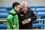 4 January 2020; Commentator Briain Tyres of TG4 checks the team lineups with Nemo Rangers selector Harry Cripps prior to the AIB GAA Football All-Ireland Senior Club Championship semi-final match between Corofin and Nemo Rangers at Cusack Park in Ennis, Clare. Photo by Brendan Moran/Sportsfile
