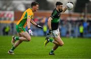 4 January 2020; Jack Horgan of Nemo Rangers in action against Ronan Steede of Corofin during the AIB GAA Football All-Ireland Senior Club Championship semi-final match between Corofin and Nemo Rangers at Cusack Park in Ennis, Clare. Photo by Brendan Moran/Sportsfile