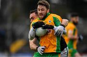 4 January 2020; Micheál Lundy of Corofin is tackled by Kieran Histon of Nemo Rangers during the AIB GAA Football All-Ireland Senior Club Championship semi-final match between Corofin and Nemo Rangers at Cusack Park in Ennis, Clare. Photo by Brendan Moran/Sportsfile