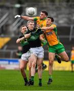4 January 2020; Alan O'Donovan and James McDermott of Nemo Rangers contest a kickout with Ronan Steede and Daithí Burke of Corofin during the AIB GAA Football All-Ireland Senior Club Championship semi-final match between Corofin and Nemo Rangers at Cusack Park in Ennis, Clare. Photo by Brendan Moran/Sportsfile