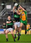 4 January 2020; James McDermott of Nemo Rangers contests a kickout with Ronan Steede and Daithí Burke of Corofin during the AIB GAA Football All-Ireland Senior Club Championship semi-final match between Corofin and Nemo Rangers at Cusack Park in Ennis, Clare. Photo by Brendan Moran/Sportsfile