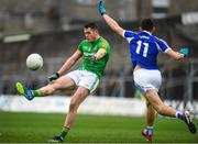 4 January 2020; Bryan Menton of Meath kicks under pressure from Mark Barry of Laois during the 2020 O'Byrne Cup Round 2 match between Meath and Laois at Pairc Tailteann in Navan, Meath. Photo by Harry Murphy/Sportsfile