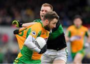 4 January 2020; Micheál Lundy of Corofin in action against Alan O'Donovan of Nemo Rangers during the AIB GAA Football All-Ireland Senior Club Championship semi-final match between Corofin and Nemo Rangers at Cusack Park in Ennis, Clare. Photo by Brendan Moran/Sportsfile