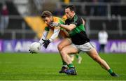4 January 2020; Micheál Lundy of Corofin in action against Alan Cronin of Nemo Rangers during the AIB GAA Football All-Ireland Senior Club Championship semi-final match between Corofin and Nemo Rangers at Cusack Park in Ennis, Clare. Photo by Brendan Moran/Sportsfile