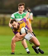 4 January 2020; Conor Carty of Wexford in action against Cathal Mangan of Offaly during the 2020 O'Byrne Cup Round 2 match between Offaly and Wexford at Faithful Fields in Kilcormac, Offaly. Photo by Matt Browne/Sportsfile