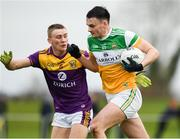 4 January 2020; Aaron Leavy of Offaly in action against Martin O'Connor of Wexford during the 2020 O'Byrne Cup Round 2 match between Offaly and Wexford at Faithful Fields in Kilcormac, Offaly. Photo by Matt Browne/Sportsfile