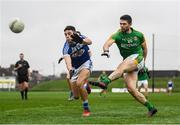 4 January 2020; Ben Brennan of Meath scores a point under pressure from Robert Pigott of Laois during the 2020 O'Byrne Cup Round 2 match between Meath and Laois at Pairc Tailteann in Navan, Meath. Photo by Harry Murphy/Sportsfile