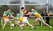 4 January 2020; Robbie Brooks of Wexford in action against David Dempsey, Brian Darby and Conor McNamee of Offaly during the 2020 O'Byrne Cup Round 2 match between Offaly and Wexford at Faithful Fields in Kilcormac, Offaly. Photo by Matt Browne/Sportsfile