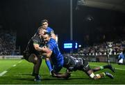 4 January 2020; Dave Kearney of Leinster dives over to score his side's second try despite the tackle of Conor Fitzgerald, left, and Niyi Adeolokun of Connacht during the Guinness PRO14 Round 10 match between Leinster and Connacht at the RDS Arena in Dublin. Photo by Ramsey Cardy/Sportsfile