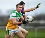 4 January 2020; Anton Sullivan of Offaly in action against Tom Byrne of Wexford during the 2020 O'Byrne Cup Round 2 match between Offaly and Wexford at Faithful Fields in Kilcormac, Offaly. Photo by Matt Browne/Sportsfile