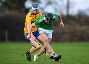 5 January 2020; Ronan Connolly of Limerick in action against Diarmuid Ryan of Clare during the Co-op Superstores Munster Hurling League 2020 Group A match between Clare and Limerick at O'Garney Park in Sixmilebridge, Clare. Photo by Harry Murphy/Sportsfile