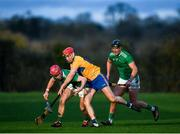 5 January 2020; Josh Considine of Limerick in action against Niall Deasy of Clare during the Co-op Superstores Munster Hurling League 2020 Group A match between Clare and Limerick at O'Garney Park in Sixmilebridge, Clare. Photo by Harry Murphy/Sportsfile