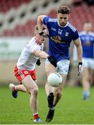 5 January 2020; Conor Madden of Cavan in action against Conal Grimes of Tyrone during the Bank of Ireland Dr McKenna Cup Round 2 match between Tyrone and Cavan at Healy Park in Omagh, Tyrone. Photo by Oliver McVeigh/Sportsfile