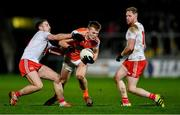 8 January 2020; Rian O'Neill of Armagh in action against Niall Sludden, left, and Frank Burns of Tyrone during the Bank of Ireland Dr McKenna Cup Round 3 match between Armagh and Tyrone at Athletic Grounds in Armagh. Photo by Piaras Ó Mídheach/Sportsfile