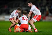 8 January 2020; Rian O'Neill of Armagh is tackled by Tyrone players, from left, Niiall Sludden, Frank Burns, and Kyle Coney during the Bank of Ireland Dr McKenna Cup Round 3 match between Armagh and Tyrone at Athletic Grounds in Armagh. Photo by Piaras Ó Mídheach/Sportsfile