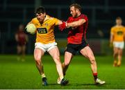 8 January 2020; Colum Duffin of Antrim in action against Darren O'Hagan of Down during the Bank of Ireland Dr McKenna Cup Round 3 match between Down and Antrim at Páirc Esler in Newry, Down. Photo by Philip Fitzpatrick/Sportsfile