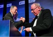 10 January 2020; Former Republic of Ireland International Packie Bonner, left, is congratulated by with Charlie Stuart after receiving his International Achievement Award during the SSE Airtricity / Soccer Writers Association of Ireland Diamond Jubilee Personality of the Year Awards 2019 at the Clayton Hotel in Dublin. Photo by Seb Daly/Sportsfile