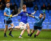 11 January 2020; Oran Kenny of Longford scores a point, under pressure from Darren Byrne of Dublin, during the O'Byrne Cup Semi-Final match between Longford and Dublin at Glennon Brothers Pearse Park in Longford. Photo by Ray McManus/Sportsfile
