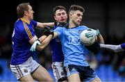 11 January 2020; Andy Foley of Dublin is tackled by Patrick Fox, left, and Michael Quinn of Longford during the O'Byrne Cup Semi-Final match between Longford and Dublin at Glennon Brothers Pearse Park in Longford. Photo by Ray McManus/Sportsfile