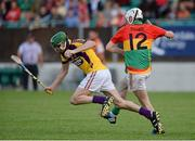 26 June 2013; Jack Hobbs, Wexford, in action against Marty Kavanagh, Carlow. Bord Gáis Energy Leinster GAA Hurling Under 21 Championship Semi-Final, Wexford v Carlow, Dr. Cullen Park, Carlow. Picture credit: Brian Lawless / SPORTSFILE