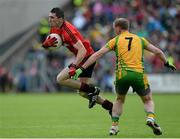 23 June 2013; Keith Quinn, Down, in action against Anthony Thompson, Donegal. Ulster GAA Football Senior Championship Semi-Final, Donegal v Down, Kingspan Breffni Park, Cavan. Picture credit: Brian Lawless / SPORTSFILE