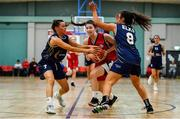 11 January 2020; Lauren Darcy of Templeogue in action against Eimile Rogers Duffy, right, and Erin Maguire of UU Tigers during the Hula Hoops U20 Women's National Cup Semi-Finall match between Templeogue BC and UU Tigers at Parochial Hall in Cork. Photo by Sam Barnes/Sportsfile