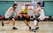 11 January 2020; Aaron Whelan of IT Carlow in action against Declan Cahill, left, and Owen Connolly of Fr Mathews during the Hula Hoops Presidents National Cup Semi-Final match between IT Carlow Basketball and Fr Mathews at Parochial Hall in Cork. Photo by Sam Barnes/Sportsfile