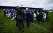 11 January 2020; Longford manager Padraic Davis is interviewed, as the players warm down, after the O'Byrne Cup Semi-Final match between Longford and Dublin at Glennon Brothers Pearse Park in Longford. Photo by Ray McManus/Sportsfile