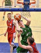 12 January 2020; Matthew Donnellan of Moycullen in action against Matthew Harper of Templeogue during the Hula Hoops U20 Men's National Cup Semi-Final between Moycullen BC and Templeogue BC at Neptune Stadium in Cork. Photo by Brendan Moran/Sportsfile
