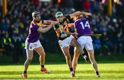 12 January 2020; Paddy Deegan of Kilkenny in action against Micheál Dwyer, left, and Billy Ryan of Kilkenny during the Walsh Cup Semi-Final match between Kilkenny and Wexford at John Lockes GAA Club, John Locke Park in Callan, Kilkenny. Photo by Ray McManus/Sportsfile