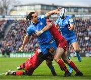 12 January 2020; James Lowe of Leinster is tackled by Noa Nakaitaci, left, and Xavier Mignot of Lyon during the Heineken Champions Cup Pool 1 Round 5 match between Leinster and Lyon at the RDS Arena in Dublin. Photo by Ramsey Cardy/Sportsfile