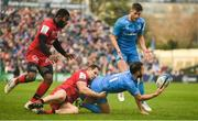 12 January 2020; Jamison Gibson-Park of Leinster offloads the ball to team-mate Ross Byrne as he is tackled by Jeremie Maurouard of Lyon during the Heineken Champions Cup Pool 1 Round 5 match between Leinster and Lyon at the RDS Arena in Dublin. Photo by David Fitzgerald/Sportsfile