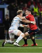 12 January 2020; JJ Hanrahan of Munster in action against Antonie Claassen of Racing 92 during the Heineken Champions Cup Pool 4 Round 5 match between Racing 92 and Munster at Paris La Defence Arena, in Paris, France. Photo by Seb Daly/Sportsfile