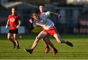 12 January 2020; Ben O'Donnell of Tyrone in action against Daniel Guinness of Down during the Bank of Ireland Dr McKenna Cup Semi-Final match between Tyrone and Down at the Athletic Grounds in Armagh. Photo by Oliver McVeigh/Sportsfile