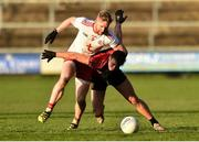 12 January 2020; Frank Burns of Tyrone in action against Barry O'Hagan of Down during the Bank of Ireland Dr McKenna Cup Semi-Final match between Tyrone and Down at the Athletic Grounds in Armagh. Photo by Oliver McVeigh/Sportsfile