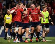 12 January 2020; Andrew Conway of Munster, centre, is congratulated by team-mates Mike Haley, left, and Niall Scannell, after scoring his side's first try during the Heineken Champions Cup Pool 4 Round 5 match between Racing 92 and Munster at Paris La Defence Arena in Paris, France. Photo by Seb Daly/Sportsfile