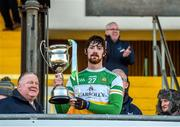 12 January 2020; Ben Conneely of Offaly lifts the cup following the Kehoe Cup Final match between Antrim and Offaly at Páirc Tailteann in Navan, Meath. Photo by Philip Fitzpatrick/Sportsfile