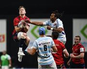 12 January 2020; Mike Haley of Munster and Teddy Thomas of Racing 92 contest a high ball during the Heineken Champions Cup Pool 4 Round 5 match between Racing 92 and Munster at Paris La Defence Arena in Paris, France. Photo by Seb Daly/Sportsfile