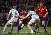 12 January 2020; Billy Holland of Munster is tackled by Dominic Bird of Racing 92 during the Heineken Champions Cup Pool 4 Round 5 match between Racing 92 and Munster at Paris La Defence Arena in Paris, France. Photo by Seb Daly/Sportsfile