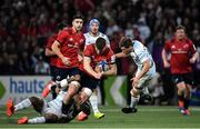 12 January 2020; Jack O'Donoghue of Munster is tackled by Virimi Vakatawa, left, and Teddy Iribaren of Racing 92 during the Heineken Champions Cup Pool 4 Round 5 match between Racing 92 and Munster at Paris La Defence Arena in Paris, France. Photo by Seb Daly/Sportsfile
