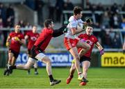 12 January 2020; Conall McCann of Tyrone in action against Kevin McKernan and Daniel Guinness of Down during the Bank of Ireland Dr McKenna Cup Semi-Final match between Tyrone and Down at the Athletic Grounds in Armagh. Photo by Oliver McVeigh/Sportsfile