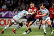 12 January 2020; Rory Scannell of Munster is tackled by Virimi Vakatawa, left, and Henry Chavancy of Racing 92 during the Heineken Champions Cup Pool 4 Round 5 match between Racing 92 and Munster at Paris La Defence Arena in Paris, France. Photo by Seb Daly/Sportsfile