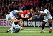 12 January 2020; Chris Farrell of Munster is tackled by Wenceslas Lauret, left, and Olivier Klemenczak, bottom, of Racing 92 during the Heineken Champions Cup Pool 4 Round 5 match between Racing 92 and Munster at Paris La Defence Arena in Paris, France. Photo by Seb Daly/Sportsfile
