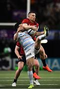 12 January 2020; Brice Dulin of Racing 92 and Andrew Conway of Munster contest a high ball during the Heineken Champions Cup Pool 4 Round 5 match between Racing 92 and Munster at Paris La Defence Arena in Paris, France. Photo by Seb Daly/Sportsfile