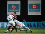 12 January 2020; JJ Hanrahan of Munster is tackled by Eddy Ben Arous, left, and Wenceslas Lauret of Racing 92 during the Heineken Champions Cup Pool 4 Round 5 match between Racing 92 and Munster at Paris La Defence Arena in Paris, France. Photo by Seb Daly/Sportsfile