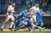18 January 2020; Luke McGrath of Leinster is tackled by Jayden Hayward of Benetton during the Heineken Champions Cup Pool 1 Round 6 match between Benetton and Leinster at the Stadio Comunale di Monigo in Treviso, Italy. Photo by Ramsey Cardy/Sportsfile