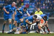 18 January 2020; Caelan Doris of Leinster is tackled by Marco Barbini, left, and Toa Halafihi of Benetton during the Heineken Champions Cup Pool 1 Round 6 match between Benetton and Leinster at the Stadio Comunale di Monigo in Treviso, Italy. Photo by Ramsey Cardy/Sportsfile