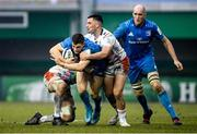 18 January 2020; Garry Ringrose with the support of his Leinster team-mate Devin Toner is tackled by Alessandro Zanni, left, and Marco Zanon of Benetton during the Heineken Champions Cup Pool 1 Round 6 match between Benetton and Leinster at the Stadio Comunale di Monigo in Treviso, Italy. Photo by Ramsey Cardy/Sportsfile