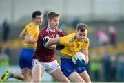 18 January 2020; Mark Richardson of Roscommon in action against Gary O'Donnell of Galway during the Connacht FBD League Final between Roscommon and Galway at Dr. Hyde Park in Roscommon. Photo by Ray Ryan/Sportsfile